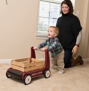 Mason pushes a wooden wagon while his mother, Jesse Campbell, watches. (PHOTO BY SUSAN KAHN)