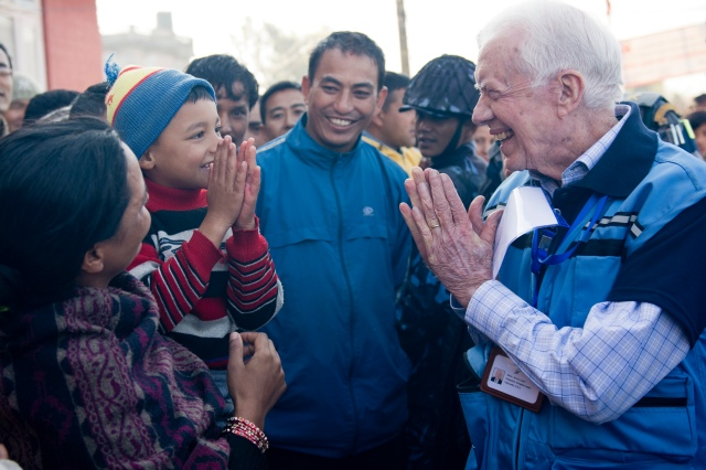 Former President Jimmy Carter greets a Nepalese boy in Kathmandu, Nepal, in November 2013, when the Carter Center monitored Nepal's constituent assembly election, sending observers from 31 countries. (PHOTO BY THE CARTER CENTER)