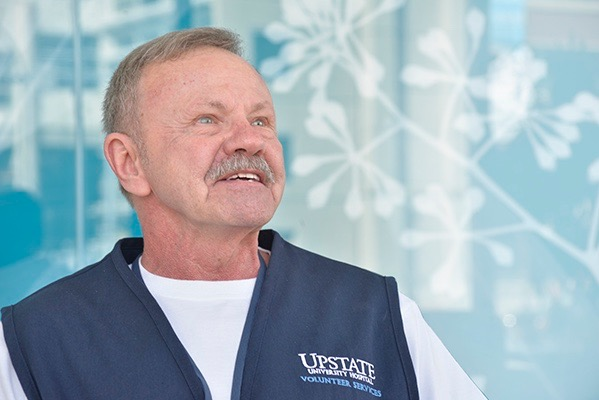 Glen Wells of Central Square volunteers at Upstate University Hospital one day a week. (PHOTO BY RICHARD WHELSKY)