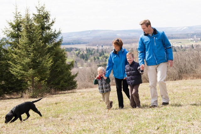 Several months after his stroke, Kyle Reger takes a walk with his wife, Martha Velky-Reger, and their sons, Jackson, left, and Max, this spring near their Cazenovia home. (PHOTO BY SUSAN KAHN)
