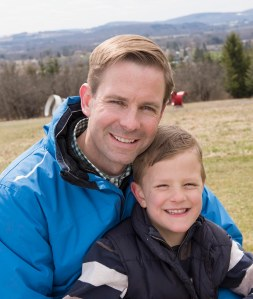 Reger with his son Max, 7, who is now considered free of cancer after being treated for WIlms' tumor as a toddler. (PHOTO BY SUSAN KAHN)