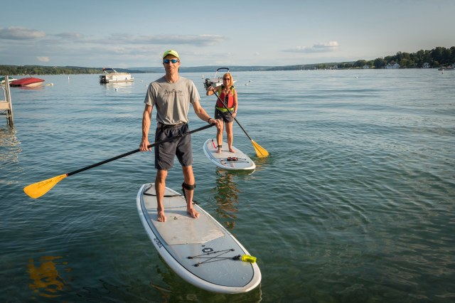 Kevin and Martha O'Keefe, who are both nurses at Upstate University Hospital, can often be found on paddleboards in Skaneateles Lake in the summertime. Their two young children like to come along, too. (PHOTO BY ROBERT MESCAVAGE)