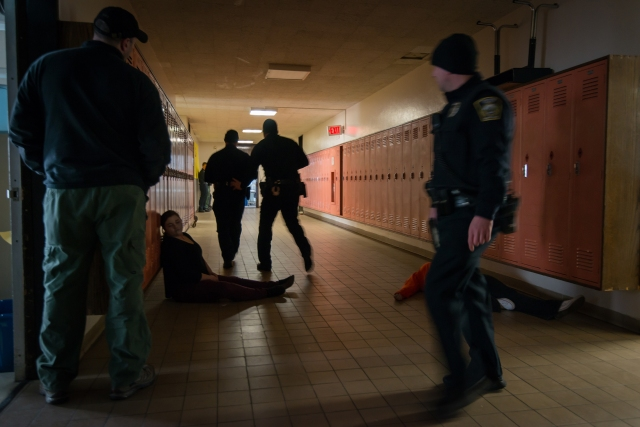 Upstate's trauma team trained with Syracuse emergency responders during a school shooting drill held at a vacant Syracuse school building in 2015. (PHOTOS BY ROBERT MESCAVAGE)