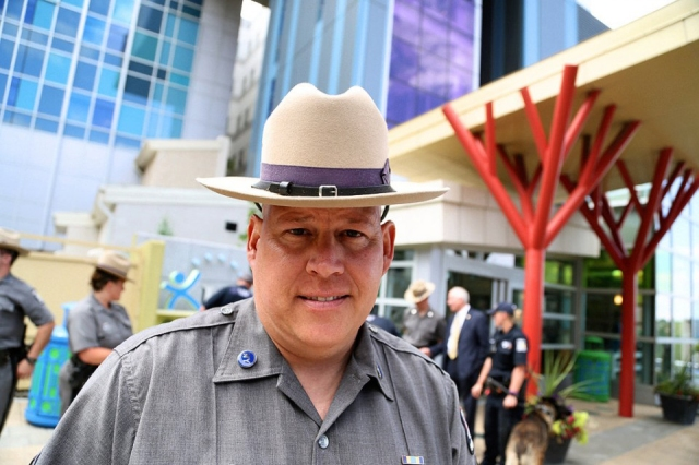 State Police Sgt. Jeff Cicora, who is battling stage 4 cancer, threw a party for patients at the Upstate Golisano Children's Hospital to take his mind off his health problems. Cicora was joined by about 20 fellow troopers and police dogs. (PHOTO BY KATHLEEN PAICE FROIO)