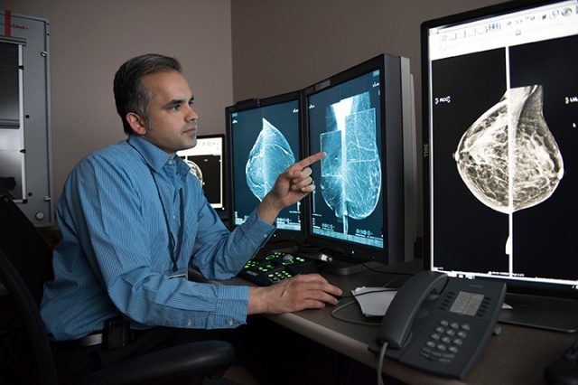 Upstate radiologist Ravi Adhikary, MD, reviews images from a 3-D mammogram. (PHOTO BY SUSAN KAHN)