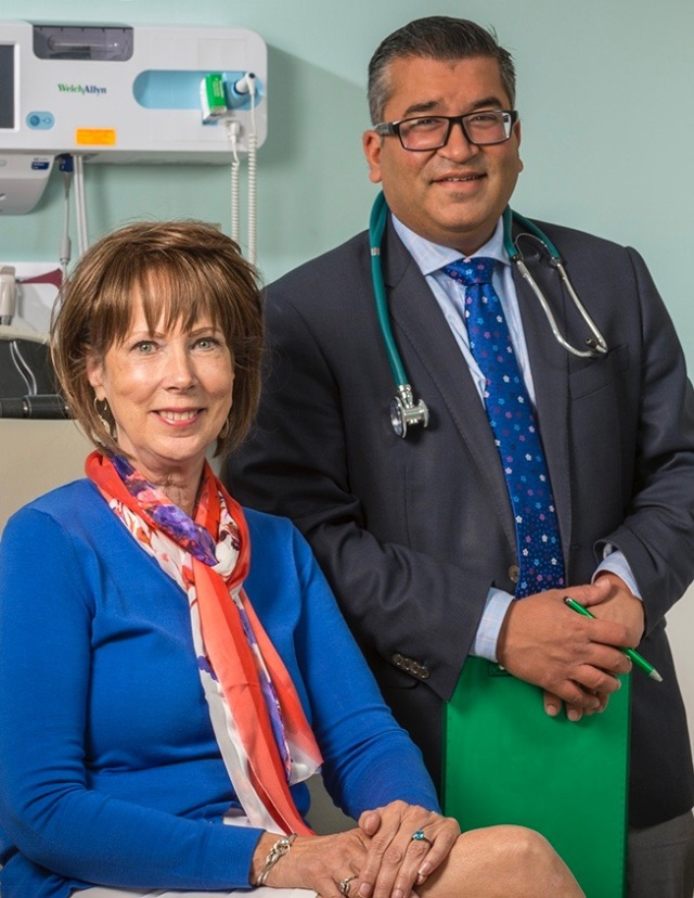 Gail Brehm with her surgeon, Ajay Jain, MD, associate chief of liver and pancreatic surgery at Upstate. Her coordinated plan showed good results. (PHOTO BY ROBERT MESCAVAGE)