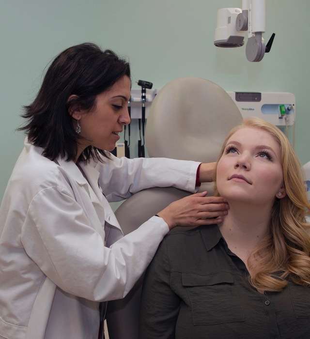 Upstate pathologist Rana Naous, MD, examines a spot in which a fine needle aspiration could be used to test a tumor in the neck for cancer. See the secondary story below for more on this procedure. (PHOTO BY WILLIAM MUELLER)