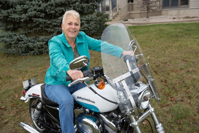 Toni Lindgren on the motorcycle she and her husband bought for her after her chemotherapy treatments for lung cancer. This winter, she plans to ride it along the eastern coast of Florida.