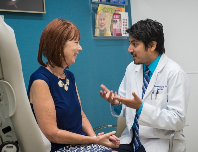 Bream with her oncologist, Muhammad Naqvi, MD. (PHOTO BY ROBERT MESCAVAGE)