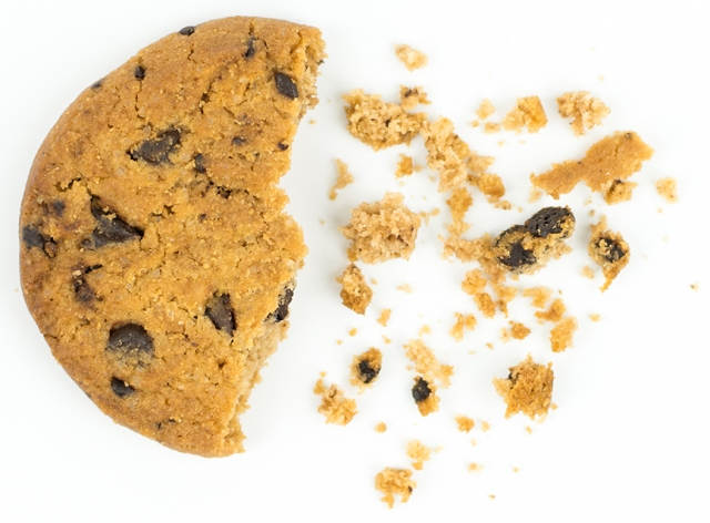 Anees Chagpar, MD, illustrates a breast tumor with a chocolate chip cookie. Chemotherapy can either cause cancers to shrink concentrically or to break apart, leaving cookie crumbs. That's why surgery, and often radiation, is recommended as a follow-up to chemotherapy, and why it's important to make sure patients have clear margins (or no crumbs at the edge of the tissue that is taken out). Speaking at Upstate last fall, Chagpar explained the difficulty in predicting which patients will have tumors that will completely disappear with chemotherapy, which will fragment or shrink and which may not respond at all.