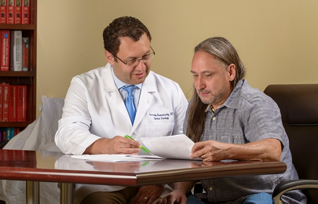 Upstate urologist Gennady Bratslavsky, MD, meets with Young. (PHOTO BY ROBERT MESCAVAGE)