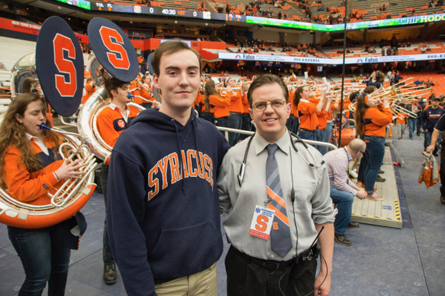 Syracuse University student Alex McMillan posed one month later with the Upstate emergency physician who helped save his life during an SU basketball game Feb. 4. Photo by Michael J. Okoniewski/Syracuse Athletics.