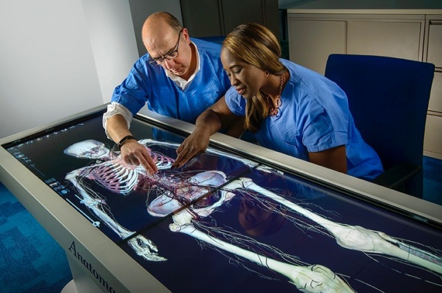Sam Carello, director of laboratory informatics at Upstate, and nurse practitioner Bridget McCarthy are shown using the anatomize table.