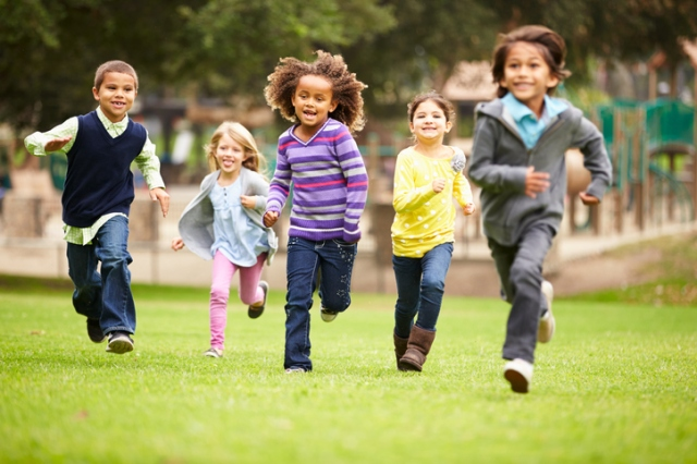 children running in a field, at play