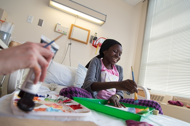 Zenabou, 17, enjoys an art therapy session during her recovery from spinal surgery to treat scoliosis at the Upstate Golisano Children's Hospital. (PHOTOS BY KATHLEEN PAICE FROIO)
