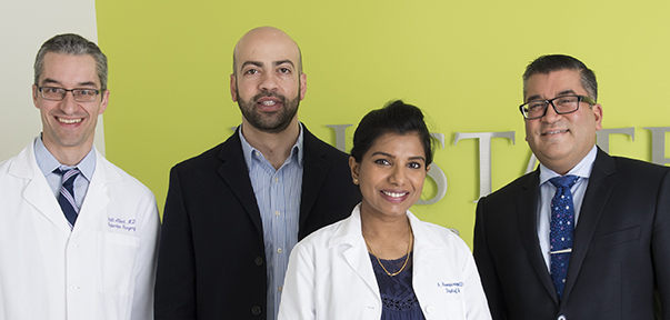 Members of the multidisciplinary melanoma team, from left: surgeon Scott Albert, MD; medical oncologist Adham Jurdi, MD; medical oncologist Abirami Sivapiragasam, MD (known as Abby Siva, MD); and surgical oncologist Ajay Jain, MD. (PHOTO BY SUSAN KAHN)