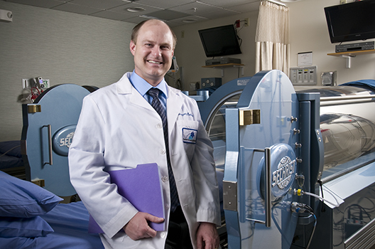 Marvin Heyboer, MD, at the hyperbaric medicine center. (PHOTO BY ROBERT MESCAVAGE)