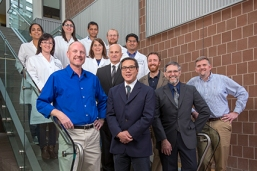 "These are some of the experts from different fields who make up the Brain Tumor Research Group. From left are: (front row) Ed Rice, Lawrence Chin, MD, Mariano Viapiano, PhD, and Russell ""Rick"" Matthews, PhD; (second row) Robert Corona Jr., DO, and Charles Danko, PhD; (third row) Malvina Prapa, PhD, Sharon Longo and Nandhu Mohan Sobhana, PhD; (fourth row) Prajna Behera, Lina Barrera Arenas, Ashis Sinha and Geoffrey Eill. Rice and Danko are from Cornell University, while the rest are from Upstate Medical University. (PHOTO BY ROBERT MESCAVAGE)"