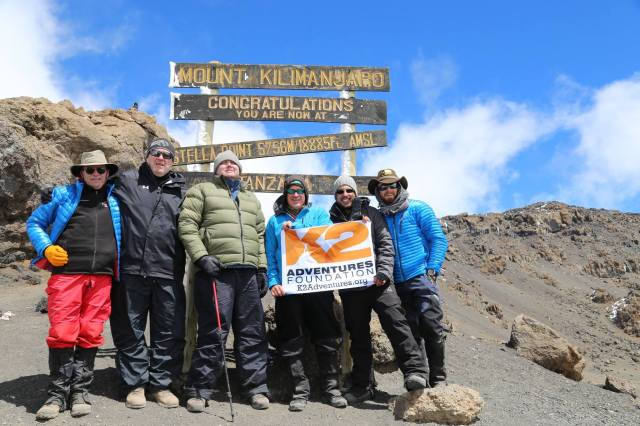 Tim Conners of Fulton, third from left, with his companions at the peak of Tanzania's Mount Kilimanjaro, Africa's highest peak, as shown on this photo from his Facebook page. The team reached the summit in early June.