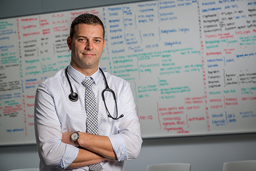 A caregiver, such as nurse practitioner Travis DeBois, above, can be a vital source of information to a patient seeking to learn more about his or her disease. (PHOTO BY ROBERT MESCAVAGE)