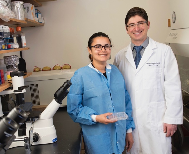 Dmitriy Nikolavsky, MD, is director of reconstructive urology at Upstate University Hospital. He has completed more than 250 urethral reconstructions over the past four years. He is shown with his wife, Daniela Nikolavsky, who works in the urology laboratory. (PHOTO BY SUSAN KAHN)