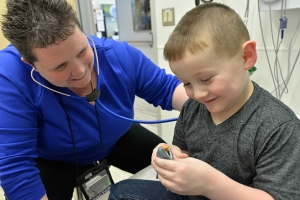 At the same checkup session, pediatric oncologist Andrea Dvorak, MD, checks Greyson's heart rate and lung function.