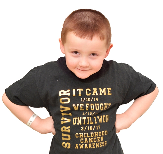 Greyson Trottier proudly wears his cancer survivor's T-shirt. (PHOTOS BY WILLIAM MUELLER)