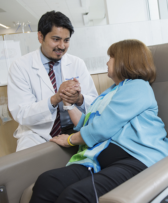 Foti with one of her oncologists, Muhammad Naqvi , MD, at the Upstate Cancer Center. (PHOTO BY SUSAN KAHN)