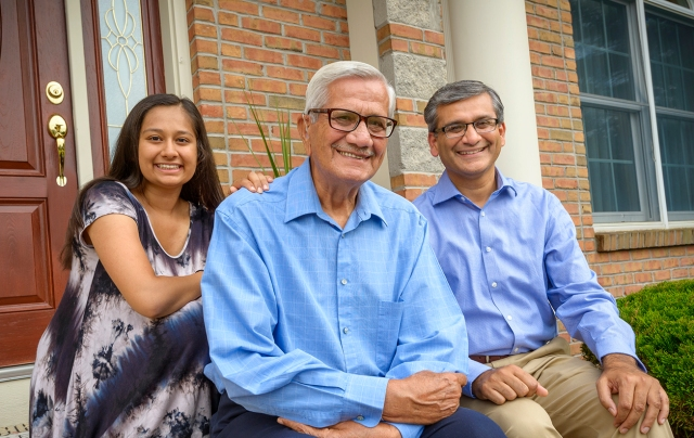 Stroke survivor Jagdish M. Saini, center, with his granddaughter, Rhea, and son, Rajeev Saini, MD, who did his internal medicine residency at Upstate. (PHOTO BY ROBERT MESCAVAGE)