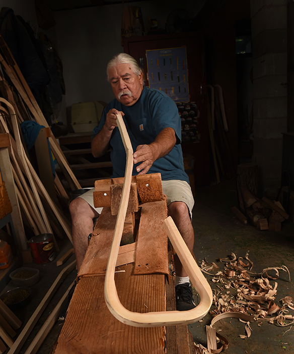 Cancer survivor Alf Jacques, 68, first began making traditional Iroquois wooden lacrosse sticks at the age of 12. He worked alongside his father, Louis Jacques, who understood the design concept but had never actually crafted sticks himself. Through trial and error, the two learned how to make sticks together. (PHOTO BY JOHN BERRY)