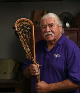 Jacques, shown with a lacrosse stick he created, says he considers himself lucky -- to have survived kidney cancer and not to have needed chemotherapy or radiation after his surgery. (PHOTO BY JOHN BERRY)