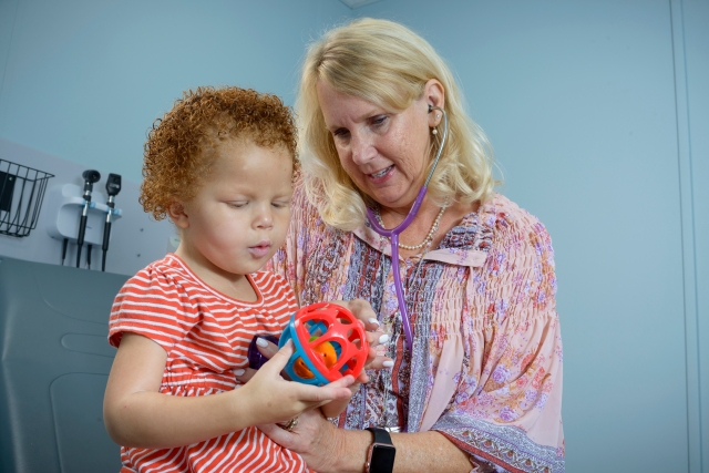 Tracy Cornell with pediatric pulmonary nurse practitioner Mary Foster. (PHOTO BY ROBERT MESCAVAGE)