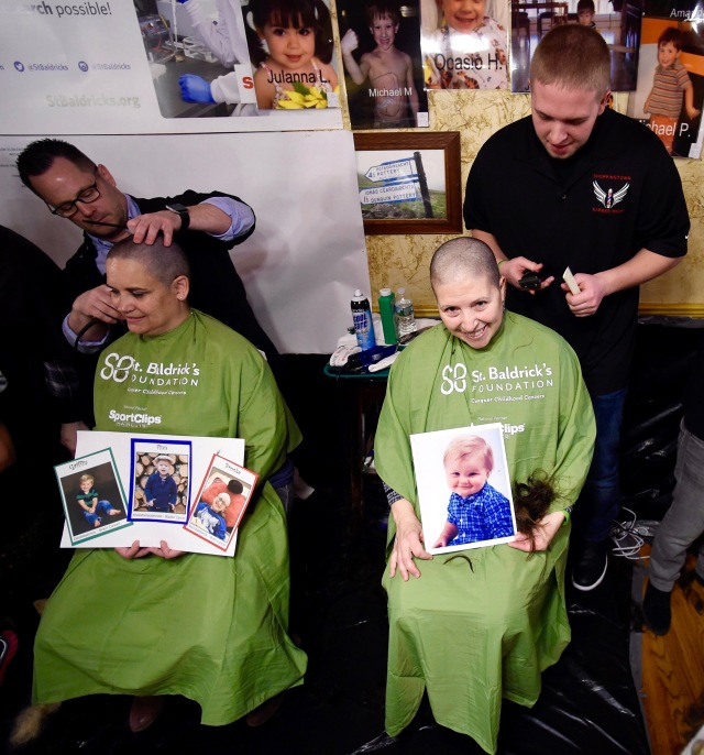 St. Baldrick's Day in Syracuse raises money for the cure of childhood cancer. Participants are shown at Kitty Hoynes, an Irish pub in Syracuse, on April 2, 2017. Last year, more than 530 people had their locks shaved off in honor of cancer survivors and those who have passed away. (PHOTO BY DENNIS NETT/syracuse.com)