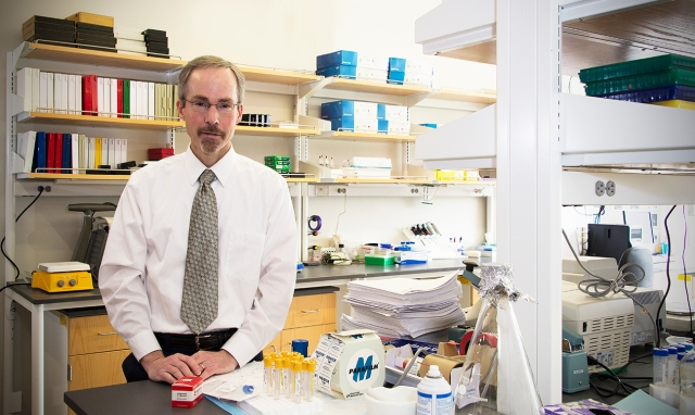 Upstate researcher Frank Middleton, PhD, is studying microRNA as a way to detect autism early, quickly and painlessly. The genetic material is present in saliva and other bodily fluids. Middleton is also doing related research into microRNA as a marker for concussion. (PHOTO BY WILLIAM MUELLER)