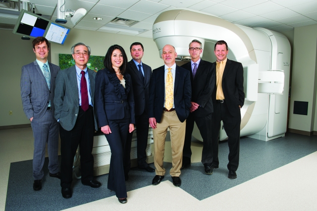 Upstate's team of radiation oncologists cares for patients in Oneida, Syracuse and Oswego. From left are Paul Aridgides, MD, Seung Shin Hahn, MD, Anna Shapiro, MD, Alexander Banashkevich, MD, Jeffrey Bogart, MD, Michael LaCombe, MD, and Michael Mix, MD. (PHOTO BY SUSAN KAHN)
