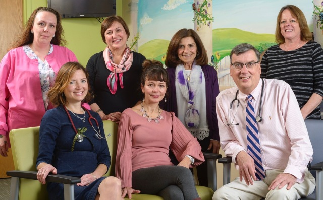 The pediatric rheumatology team at Upstate: standing, from left, are medical assistant Kelley Baker, nurse Vickie Keeler and administrative assistants Kathy Messina and Rebecca Wisnowski. Seated, from left, are Caitlin Sgarlat Deluca, DO, nurse Dori Brier and William Hannan, MD. (PHOTO BY ROBERT MESCAVAGE)