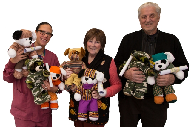Child life specialist Gina Lozito-Yorton, left, with Glenda and Fred Stowell, who create and donate stuffed animals to children at the Upstate Golisano Children's Hospital. (PHOTO BY KATHLEEN PAICE FROIO)