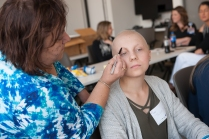 Cosmetologist Maria Ascrizzi draw eyebrows on Taylor Way. It is not uncommon for patients to lose hair during chemotherapy treatments. (PHOTO BY SUSAN KAHN)