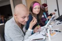 """Taylor Way, 15, experiments with makeup during a """"Look Good Feel Better"""" session at the Upstate Cancer Center. With her are Amanda Wilson, 16, and Julia Nguyen, 16. (PHOTO BY SUSAN KAHN)"""