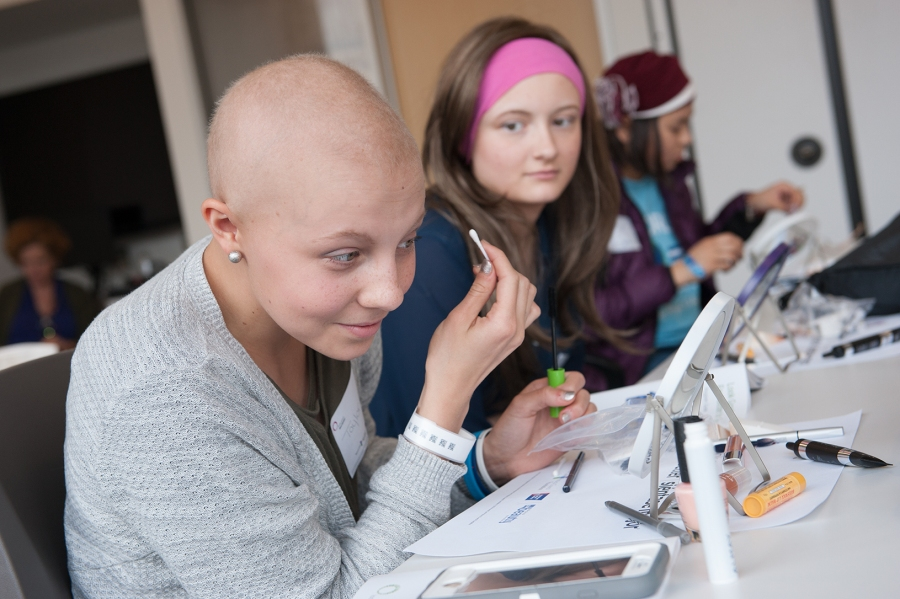 "Taylor Way, 15, experiments with makeup during a ""Look Good Feel Better"" session at the Upstate Cancer Center. With her are Amanda Wilson, 16, and Julia Nguyen, 16. (PHOTO BY SUSAN KAHN)"