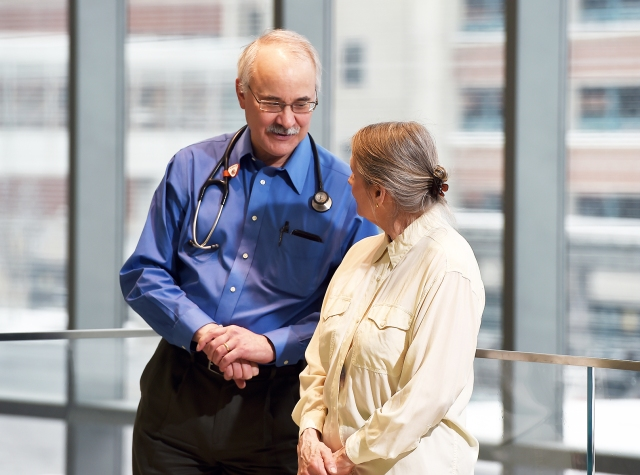 Upstate oncologist Stephen Graziano, MD, talks with his patient, Sandra Floyd. (photos by John Berry)