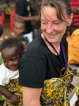 Lauri Rupracht, an Upstate pediatric nurse and founder of the Americans Serving Abroad Program, or ASAP, holds a baby during a November 2017 mission trip in Ghana. (PHOTO BY MEGHAN LEWIS)