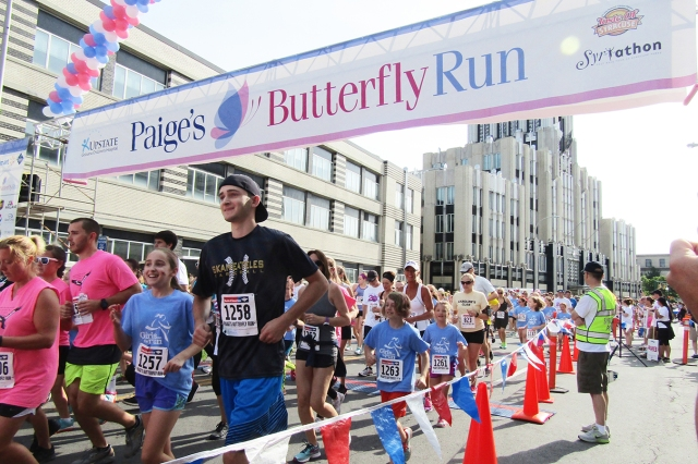 Runners of all ages participate in Paige's Butterfly Run to support children with cancer. (photo by Susan Keeter)