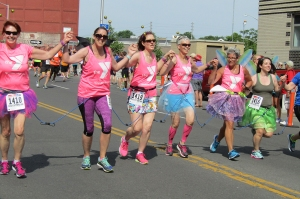 Tutus and butterfly wings were part of the uniform for this YMCA team at Paige's Butterfly Run. (photo by Susan Keeter)