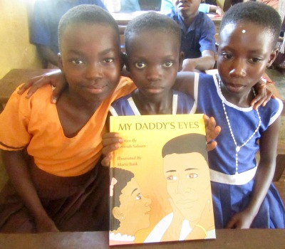 "Every school received autographed copies of ""My Daddy's Eyes"" by Syracuse author Fatimah Salaam. (PHOTO BY SUSAN KEETER)"