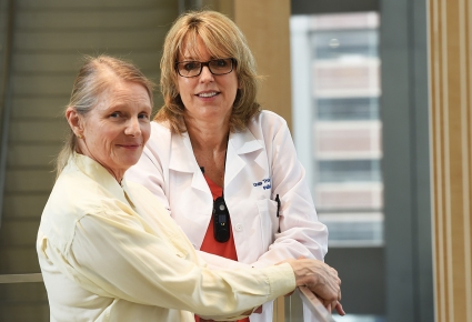 Floyd, left, with Linda Troia, a physician assistant in the palliative care service at the Upstate Cancer Center.