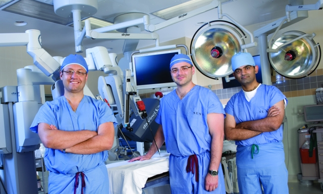 From left, urologists Gennady Bratslavsky, MD, Oleg Shapiro, MD, and Rakesh Khanna, MD, in one of the robotic surgery suites. Upstate has 13 robotically trained urologic surgeons, performing the highest volumes in the region. Other distinctions include the region's first thoracic and hepatobiliary robotic surgery teams, to treat cancer and other conditions involving the chest, liver, gallbladder and pancreas. (photo by Susan Kahn)