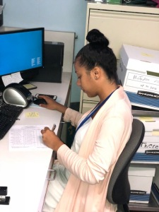 Vivian Gousby, a Le Moyne College student, at work at Upstate's Margaret L. Williams Developmental Evaluation Center. (Photo by Amani Mike)
