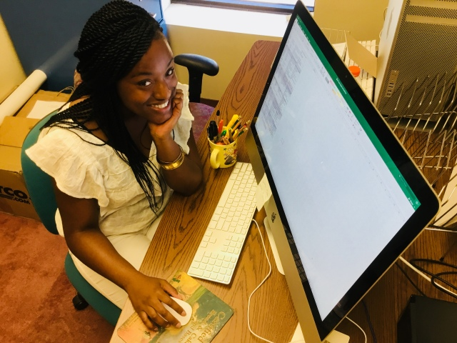 Amani Mike, a student at SUNY College at Brockport, has a summer internship at Upstate Medical University, thanks to a partnership with Synergy. (Photo by Susan Keeter)