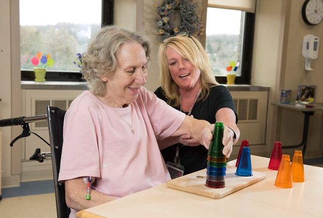 Barbara King, left, works with occupational therapist Kelly Ryan. (Photo by Susan Kahn)